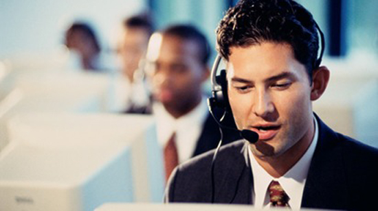 Male customer service representative sitting in fr
